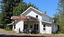 Remote, Coos County, Oregon off of present day Highway 42. Photograph of the Post Office, Store, and gas station.