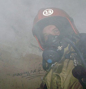 Russian State Fire Service - Russian Firefighter with a Head of duty shift fire station helmet.
