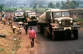 Great Lakes refugee crisis - Convoy of American military vehicles bring fresh water from Goma to Rwandan refugees located at Camp Kimbumba, Zaire in August 1994