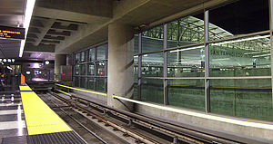 San Francisco International Airport station - Station tracks with the International Terminal visible through the windows