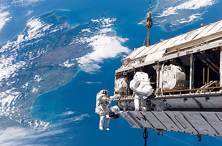 International Space Station assembly EVA made during the STS-116 mission. Robert Curbeam (with red stripes) together with Christer Fuglesang over Cook Strait, New Zealand. STS-116 spacewalk 1.jpg