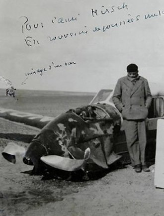 The Little Prince - Saint-Exupéry next to his downed Simoun (lacking an all-critical radio) after crashing into the Sahara about 3 am during an air race to Saigon, Vietnam. His survival ordeal was about to begin (Egypt, 1935).