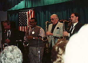 Jeff Clayton - From left: From left: Spike Robinson, Jeff Clayton, Fraser MacPherson, Ken Peplowski at Otter Crest, Oregon in May 1989. Photo courtesy of the Fraser MacPherson estate