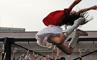 """Momoiro Clover Z - Kanako Momota performing her iconic """"Shrimp jump"""""""