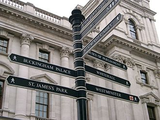 Tourism in London - A signpost on Parliament Square with directions for nearby attractions