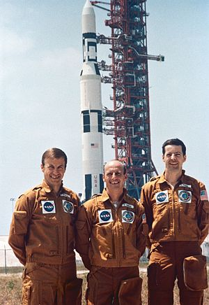 Skylab 2 - Paul J. Weitz, (left) Charles Conrad Jr. (middle); and Joseph P. Kerwin (right); in front of Skylab station on its Saturn V