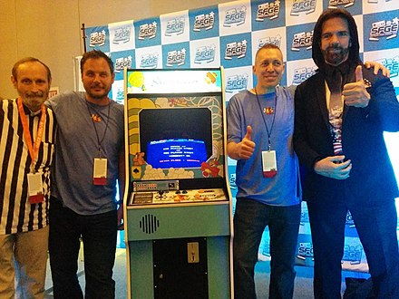 Day at the reveal of a restored Sky Skipper cabinet in 2017. Billy Mitchell is at the far right. Skyskipperreveal.jpg