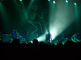 Social Distortion - The band's skeleton logo on a banner during a live show