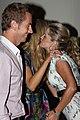 Sophie Falkiner hugging Delta Goodrem, on the left her husband Tony Thomas.jpg