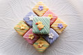 Stacked Easter petits fours with flower and duck decorations.jpg