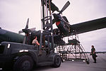 Staff Sgt. Penland, 317th Field Maintenance Squadron, uses a forklift to move a C-130 Hercules engine into place during Exercise Market Square III DF-ST-90-10114.jpg