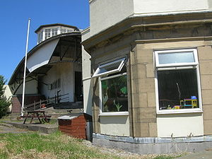 Stanley Park Aerodrome - 1930s club house (centre), offices (right) and observation/control tower (top) taken from the airfield site in June 2009. Now used as part of the elephant enclosure.