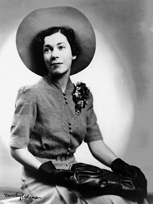 Halo hat - Australian bride wearing a large halo-effect hat, 1941
