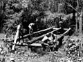 StateLibQld 2 202803 Students from the St. Lucia Farm School constructing a bridge over a creek at Moggill, Brisbane, 1937.jpg