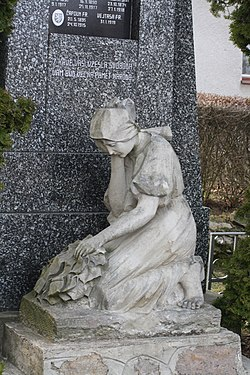 Statue of woman by WWI memorial in Zárubice, Třebíč District.jpg