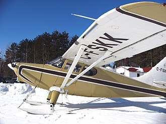 Stinson 108 - A Canadian 1949 model Stinson 108-3 on skis. The partial span leading edge slot is visible