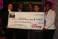 Students Receive Scholarship Check from Disney.jpg