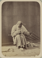 Syr Darya Oblast. City of Ura Tiube and the Types of People Seen on Its Streets. Market Square. Mender of Broken Dishes WDL10963.png