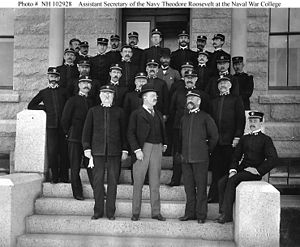 Naval War College - Assistant Secretary of the Navy Theodore Roosevelt on the steps of the Naval War College with faculty and students.