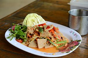 Chả lụa - Chả lụa has been incorporated into Thai cuisine under the name mu yo, and is widely eaten all over Thailand. Here it is shown with a som tam style dressing