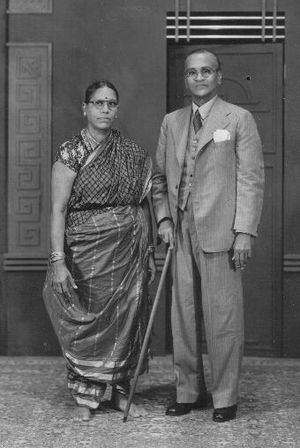 Madisar - A Tamil couple c. 1945; the wife is wearing a madisar sari.