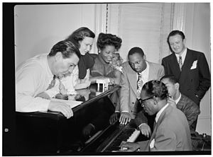 Mary Lou Williams - Mary Lou Williams in her apartment with Jack Teagarden, Tadd Dameron, Hank Jones and Dizzy Gillespie