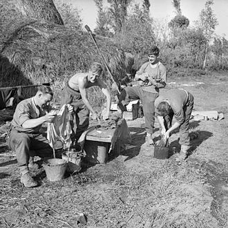 Sherwood Foresters - Men of the 5th Battalion, Sherwood Foresters do their washing while out of the line, Italy, 4 November 1943.
