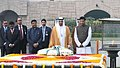The Crown Prince of Abu Dhabi, Deputy Supreme Commander of U.A.E. Armed Forces, General Sheikh Mohammed Bin Zayed Al Nahyan paying homage at the Samadhi of Mahatma Gandhi, at Rajghat, in Delhi.jpg