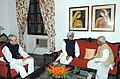 The Governor of West Bengal, Shri Gopal Krishna Gandhi and the Chief Minister of West Bengal, Shri Buddhadeb Bhattacharya meeting the Prime Minister, Dr. Manmohan Singh in Kolkata on January 11, 2005.jpg