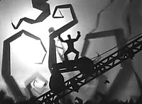 A silhouette of a man holding his arms in the air stands atop a wheeled platform ascending a diagonal girder. The backdrop is foggy and white, with silhouettes of curving trees and shapes visible.