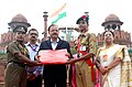 The Minister of State for Defence, Dr. Subhash Ramrao Bhamre presenting the memento to a NCC Cadet of the three wings, during the Independence Day Celebrations - 2018 rehearsal, at Red Fort, in Delhi on August 13, 2018 (1).JPG
