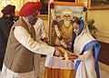 The President, Smt. Pratibha Devisingh Patil being presented a Saropa (Kirpan), on the occasion of Birthday of Guru Nanak Devji, at Rashtrapati Bhavan, in New Delhi on November 20, 2010.jpg