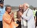 The Prime Minister, Shri Narendra Modi being received by the Governor of Uttar Pradesh, Shri Ram Naik and the Chief Minister of Uttar Pradesh, Yogi Adityanath, on his arrival, at Varanasi, Uttar Pradesh on March 12, 2018 (1).jpg