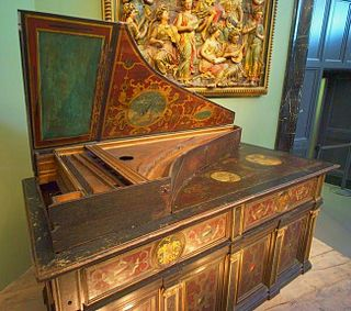 Claviorgan combination of a stringed instrument (usually a keyboard instrument) and an organ