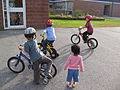 Three boys on training wheels.jpg