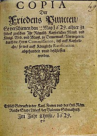 Treaty of Lübeck (1629), with the Gregorian day (22) directly above the Julian day (12), both before the name of the month, May. The treaty was made between Catholic parties who had already begun using the Gregorian calendar, and Protestant parties who had not.