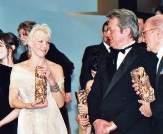 25th César Awards - Tonie Marshall (left), Best Director winner, and President of the Ceremony Alain Delon