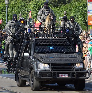 Federal Police Special Units - DSU operators on a parade armed with FN SCARs on a Toyota Land Cruiser assault vehicle.