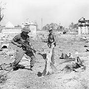 Troops of the West Yorkshire Regiment warily search Japanese dugouts in Meiktila, Burma, 28 February 1945. SE3287