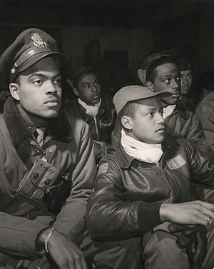 Military history of African Americans -  Tuskegee Airmen of the 332nd Fighter Group, United States Army Air Forces (USAAF), attend a briefing at Ramitelli Airfield, Italy in March 1945.