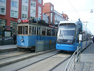Trams in Stockholm - Old and new tram on Tvärbanan, 2010.