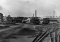 Two railway engines outside the Gear Meat Company, Petone ATLIB 140888.png