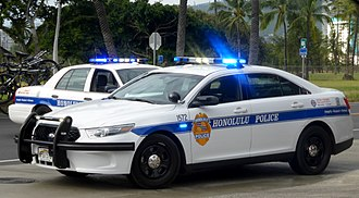 Honolulu Police Department - Two Honolulu Police Cars with their lights on, 2015