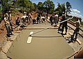 U.S. Air Force and Philippine air force engineers smooth concrete while laying the foundation for a new schoolhouse April 1, 2013, in Omaya, Philippines 130401-N-VN372-145.jpg