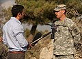 U.S. Army Capt. Kyle Surridge, right, the commander of Alpha Battery, 5th Battalion, 7th Air Defense Artillery Regiment, gives an interview with an Israeli television reporter 121023-F-OT114-002.jpg
