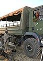 U.S. Army Pfc. Ronnie Okello, left, a fuel handler with Alpha Company, 405th Brigade Support Battalion, Illinois Army National Guard, fuels a vehicle for the Botswana Defence Force during Southern Accord 2012 120809-Z-VI159-168.jpg