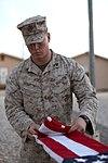 U.S. Marine Corps Cpl. Brett MegarityKoch folds a U.S. flag at Camp Leatherneck, Helmand province, Afghanistan, March 15, 2013 130315-M-KS710-056.jpg