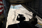 U.S. Marine Corps Cpl. Ryan P. Wells, a crew chief with Marine Heavy Helicopter Squadron (HMH) 462, provides aerial security from inside a CH-53E Super Stallion helicopter over Helmand province, Afghanistan 131007-M-SA716-099.jpg