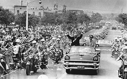 With President Chiang Kai-shek, the US President Dwight D. Eisenhower waved to crowds during his visit to Taipei in June 1960. U.S. President Eisenhower visited TAIWAN 美國總統艾森豪於1960年6月訪問臺灣台北時與蔣中正總統-2.jpg