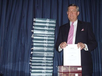 FairTax - Rep John Linder holding the 133 page Fair Tax Act of 2007 in contrast to the then-current U.S. tax code and IRS regulations.